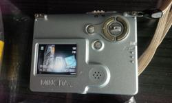 Used camera with Xenon Flash. Comes with 128MB and 64MB