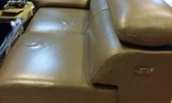 One L-shape leather sofa and 1 glass coffee table for