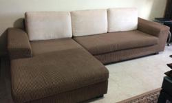 L Shaped 4 seater in as-new condition sofa Color: Brown