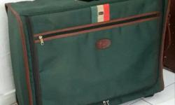 Lark large green retro luggage bag. This brand is owned