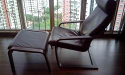 A used 2-year old leather lounger with leg rest. In