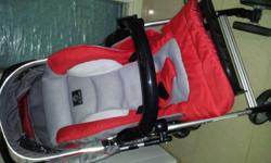 Very lightly used, light weight Capella stroller in Red
