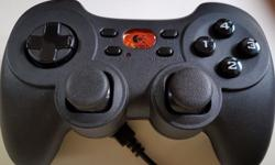 Wireless game pad with USB receiver. Needs two AA