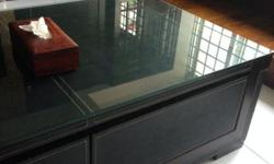 Good condition. Dark brown table with tempered glass
