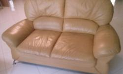 Lemon colour two seaters sofa in good condition giving
