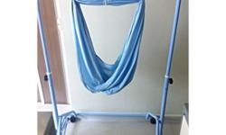 Blue manual spring cot with 4 lockable wheels. Sturdy
