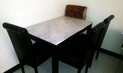 Marble dining table wih 4 chairs. Bought just 4 months