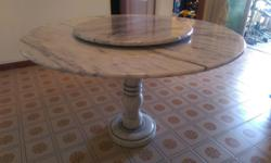 Well-maintained full marble dining table with marble
