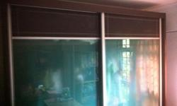 2 sliding doors with tampered glasses door. Walnut and