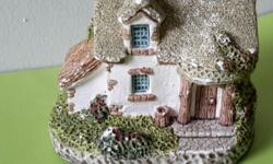 Miniature fairy tale cottage stone house statue. See