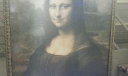 Mona Lisa portrait with gold tinted frame.74cm x