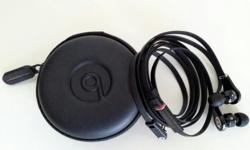 Used Monster Beats in-ear headphones with case