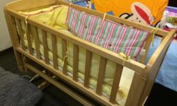 At a Glance The Mothercare Deluxe Gliding Crib sends
