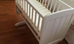 White Mothercare swinging crib with mattress,