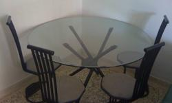 Moving out sale. Round Diningtable - Glass top with