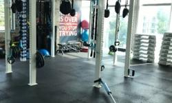 Olympic bar, hanging suspension trainers, dumbbells and