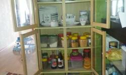Cabinet currently used to display cutlery and other