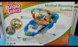 A cradling bouncer couple with 12 melodies (with