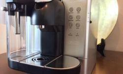 selling his used coffee machine for $400,after upgraded