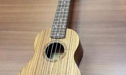 "24"" Concert Ukulele At $99 W Free pick ,bag and"