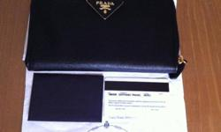 - 100% authentic black PRADA Wallet IM0506 selling at