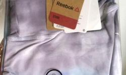 This new, never-opened Reebok strappy tank top (size