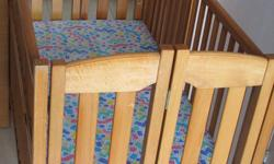 Wooden baby cot,used for two years,still in good