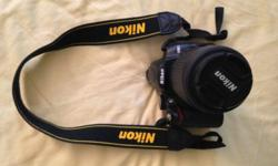 Nikon D5000 body with Nikon strap (Bought: S$1190)