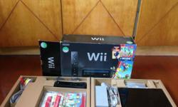 Nintendo Wii game console. 1 Wii remote plus and 1