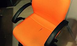 Selling office medium high back chair used. Orange