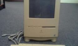 Cute old Mac with kepboard and writer (printer) for
