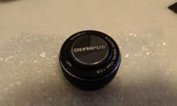 Selling a never before used Olympus EW-M1728 M.ZUIKO