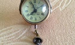 This is an antique crystal ball fob watch ! Winds-up