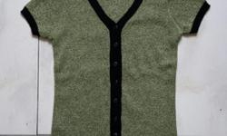 Green blouse. Highly strechable material. Very new and
