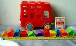 Shape sorter red bus, with 11 multi colour blocks and