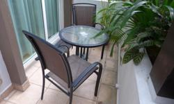 Preloved outdoor furniture: table and 2 chairs. Glass