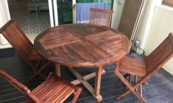 Outdoor teak table with 4 chairs. Great condition