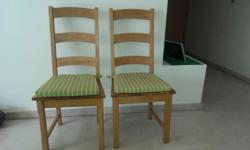 Selling a pair of very sturdy and classy wooden chairs