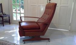 Used Parker Knoll chair/recliner. Upholstered in faux