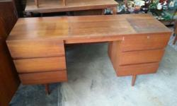 1970s Teakwood Pencil Leg Writing Table for sale! .