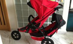 Red Phil & teds E3 double stroller. Main seat reclines