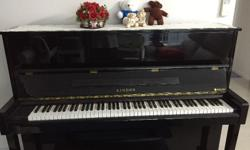 Exam upright model Piano with Kawai action. Branded as