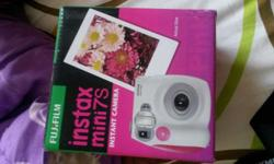 Selling polaroid camera used 1day only. looking at $100