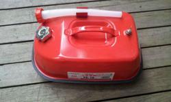 used only once, still very new. portable fuel tank for
