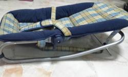 Pre-loved padded baby bouncer. Cover is removable with