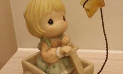 Precious moments figurines price range from $25~$45.