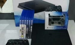 Selling 1 PS3 console with stand, 2 controllers, 9 good