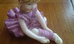 Sweet lovely purple doll. Bought many years ago -