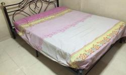 Queen size bed frame black colour in nice condition.ask