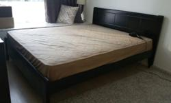 Brand new queen size bed frame and mattress. Only used